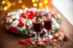 Christmas hot mulled wine with spices on a wooden table. Royalty Free Stock Images