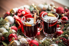 Christmas hot mulled wine with spices on a wooden table. Royalty Free Stock Photo