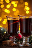 Christmas hot mulled wine with spices on a wooden table. Stock Images