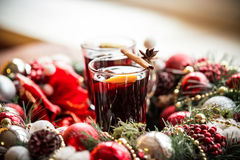 Christmas hot mulled wine with spices on a wooden table. Royalty Free Stock Image