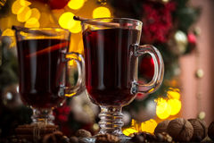 Christmas hot mulled wine with spices on a wooden table. Stock Image
