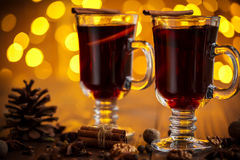 Christmas hot mulled wine with spices on a wooden table. Stock Photo