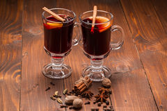 Christmas hot mulled wine with spices on a wooden table Stock Image