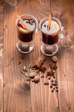 Christmas hot mulled wine with spices on a wooden table Stock Photo