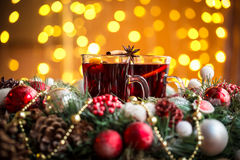 Christmas hot mulled wine with spices on a wooden table. Stock Photos