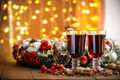 Christmas hot mulled wine with spices on a wooden table. Stock Photography