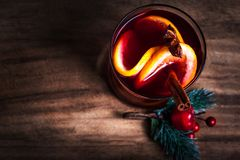 Christmas Hot mulled wine for winter with spices and orange slic Royalty Free Stock Photo
