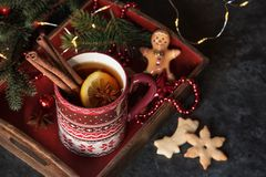 Cup of tea with christmas cookies. Christmas hot tea with lemon and cinnamon at the table with christmas decoration and cookies stock photo