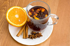 Christmas hot wine with oranges on wooden table stock images