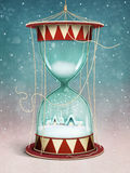 Christmas Hourglass. Holiday greeting card or poster Christmas or New Year's Eve and Hourglass village landscape and snow inside. Computer graphics Royalty Free Stock Images
