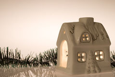 Christmas house. With candlelight inside Royalty Free Stock Images