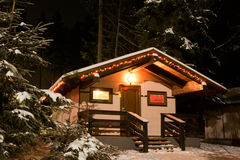 Christmas House. Small cottage in the forest covered by snow stock images