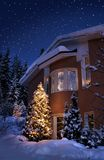 Christmas house. Idyllic Christmas time house in blue winter evening moment Stock Photo