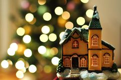 Christmas house. Miniature house with christmas tree blur background stock image