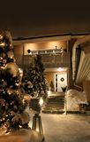 Christmas house entrance. Snowy entrance of house in idyllic Christmas time evening light Stock Photography