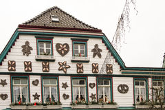Christmas House in Germany. Decorated house at christmas time with hearts, pretzels and stars made of gingerbread. The house is adapted from the tale Hansel and Royalty Free Stock Image
