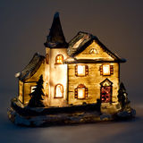 Christmas House with light inside. On gray Royalty Free Stock Photo
