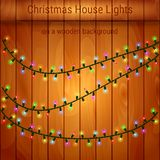 Christmas house lights on a wooden background. Luminous garlands for greeting cards, invitations and gift cards vector illustration