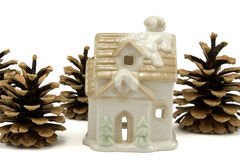 Christmas  house and pine cones Royalty Free Stock Image
