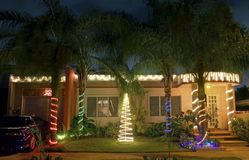 Christmas house in Puerto Rico. A basic house decorated with Christmas lights to celebrate the season.  Photographed December 17, in Bayamon Puerto Rico Stock Photo