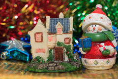 Christmas house and snowman Stock Photos
