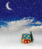 Christmas house under blue sky Royalty Free Stock Photos