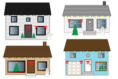 Christmas Houses. Houses decorated with Christmas decorations, including snowmen, Christmas trees, lights and red bows Royalty Free Stock Images