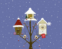 Christmas houses. Christmas greeting card with heartwarming winter houses on a tree Stock Image