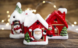 Christmas houses decorations with festive lights on wooden board Stock Image