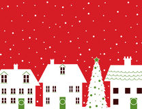 Christmas houses and snow red background Royalty Free Stock Photos