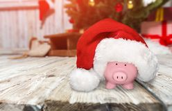Christmas. Humor piggy bank charity and relief work home finances coin bank savings Stock Photo