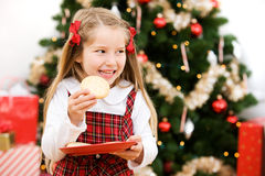 Christmas: Hungry Girls Eats Santa's Sugar Cookie Stock Photos