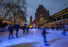 Christmas Ice Rink at the Natural History Museum in London Royalty Free Stock Image