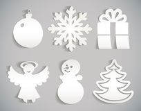 Christmas icon cut from paper. Snowflake, snowman, Christmas decorations, angel, Christmas tree, gift. Christmas icon cut from paper.  on gray background. Vector Stock Images