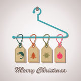 Christmas icon labels hanging on a hanger Royalty Free Stock Photography