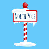 Christmas icon north pole sign with snow and ice, winter holiday xmas symbol, cartoon banner Stock Photo