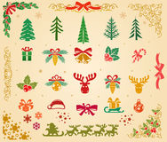 Christmas Icons Set on Parchment. Assorted Christmas icons or symbols on a parchment colored background Stock Photo