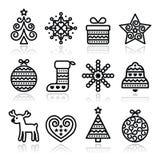 Christmas icons with stroke - Xmas tree, present, reindeer. Vector black icons set for celebrating Xmas  on white Royalty Free Stock Photos