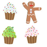 Christmas icons , three cupcakes and a gingerbread man Stock Photography