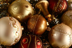 Christmas II. A few pieces of Christmas decoration - balls and a bell in white, red, gold and silver, with glittering background Stock Photography