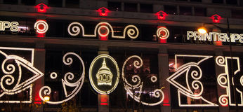 Christmas illumination on facade of Printemps department store in Paris. Stock Photography
