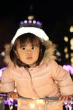 Christmas illumination and Japanese girl. 3 years old Royalty Free Stock Photography