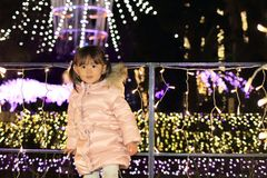 Christmas illumination and Japanese girl. 3 years old Royalty Free Stock Image