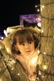 Christmas illumination and Japanese girl. 3 years old Royalty Free Stock Images