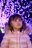 Christmas illumination and Japanese girl. 3 years old Royalty Free Stock Photos