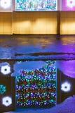 Christmas illumination reflected in puddle stock image