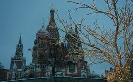Christmas illumination and St. Basil`s Cathedral. View of St. Basil`s Cathedral and the Kremlin with Christmas illumination in the evening royalty free stock photos