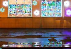 Christmas illumination, wet bench and rain puddle Stock Photo