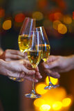 Christmas illuminations and champagne glass. Stock Photos