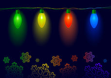 Christmas illuminations. Lamps and snowflakes on a dark background Stock Photography